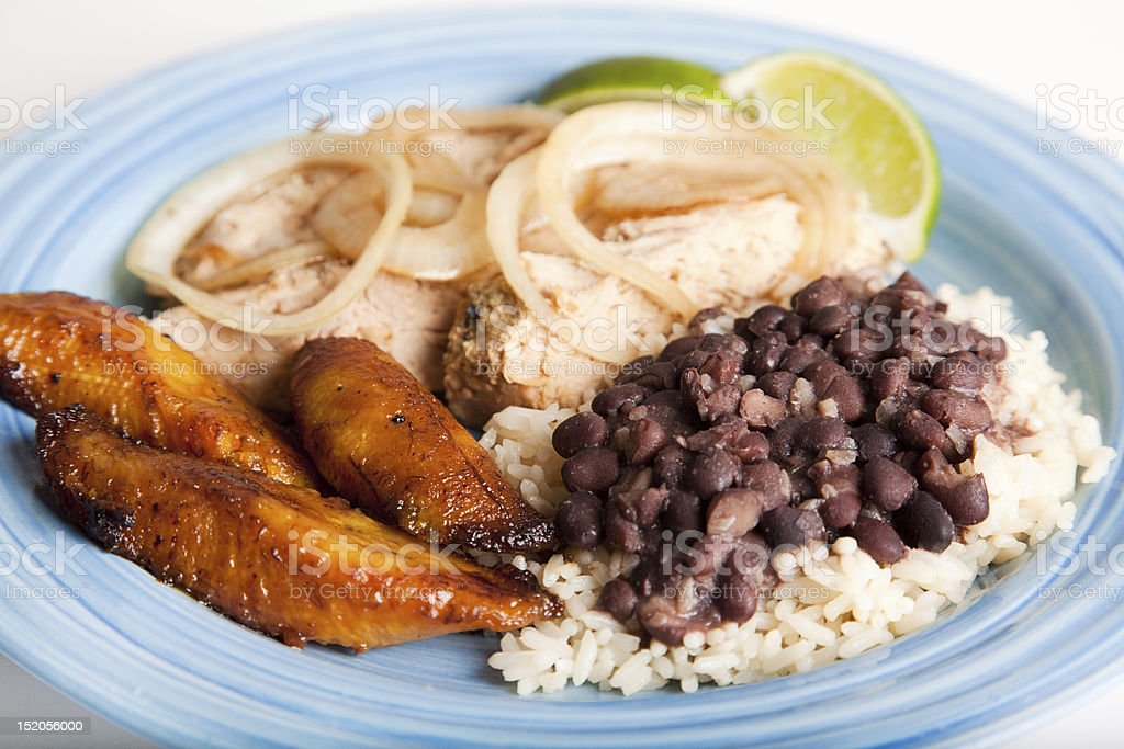 Blue plate of Cuban cuisine on white surface stock photo