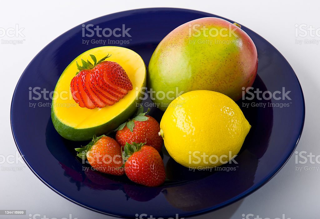 Blue Plate with Colorful Fruit royalty-free stock photo