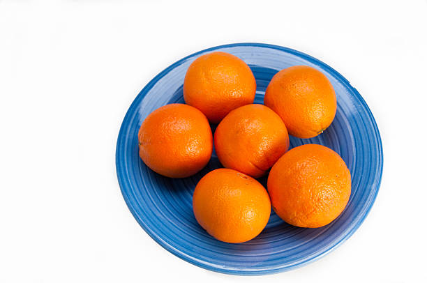Blue plate with six oranges stock photo