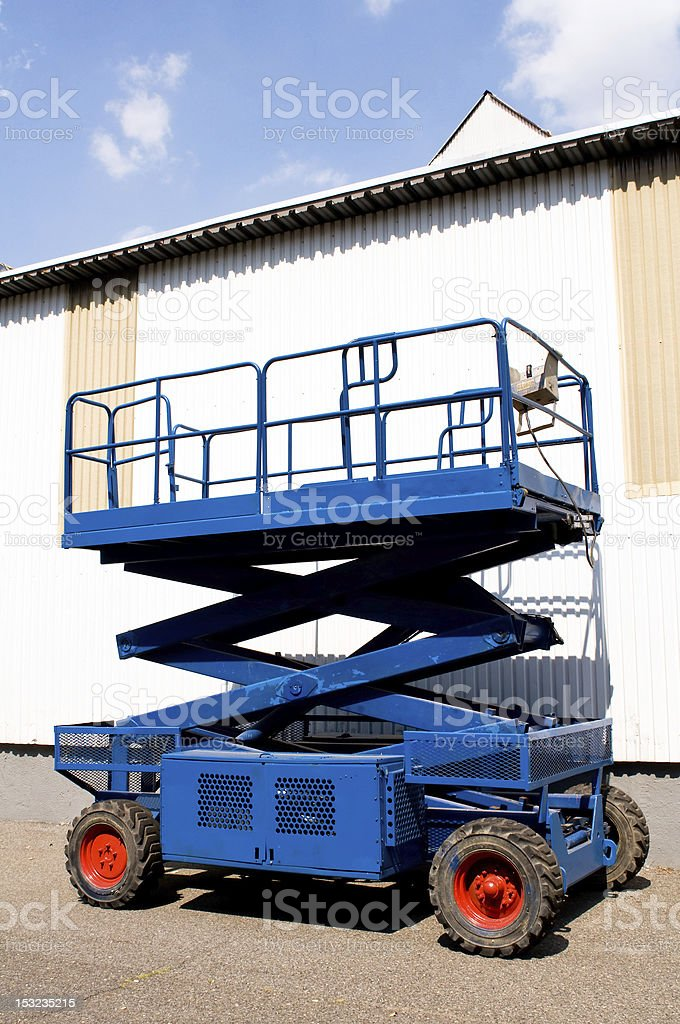 Blue platform for aerial work on buildings stock photo