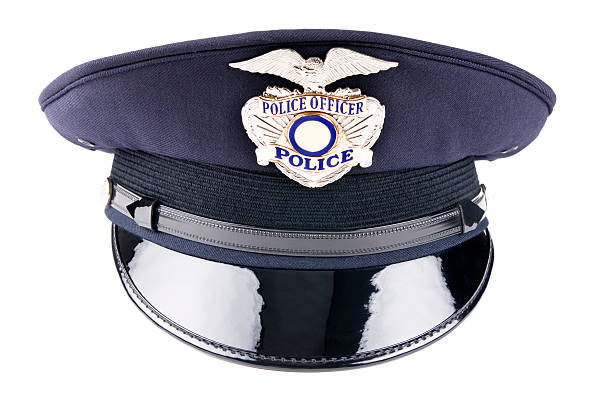 A blue police cap against a white background stock photo