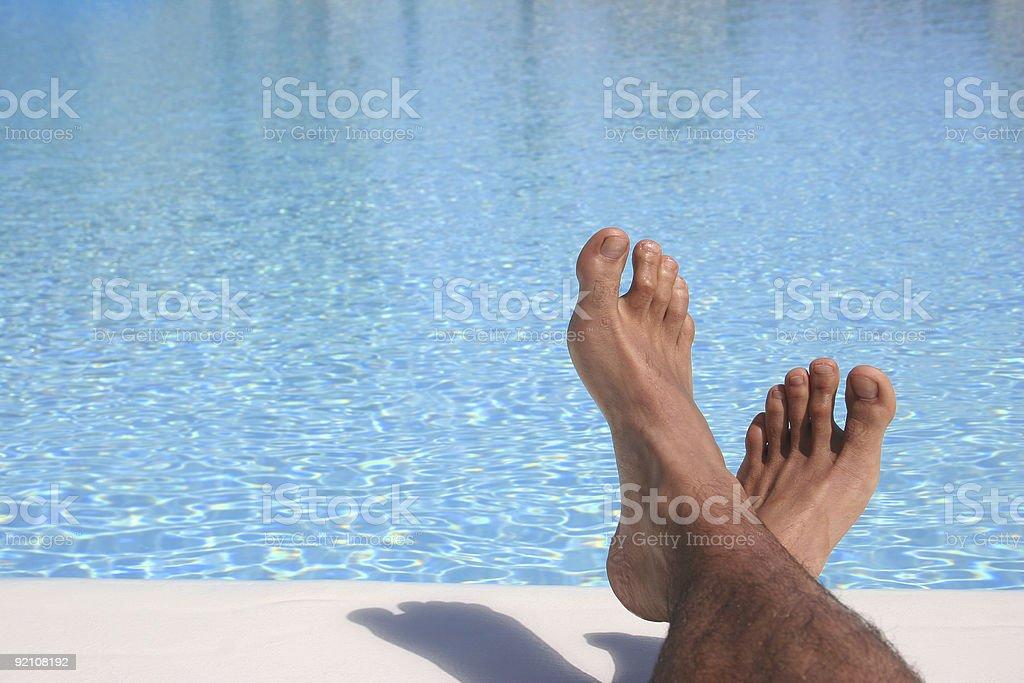 Blue Pool Feet royalty-free stock photo