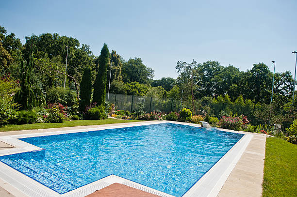 Blue pool outdoor at sunny day stock photo