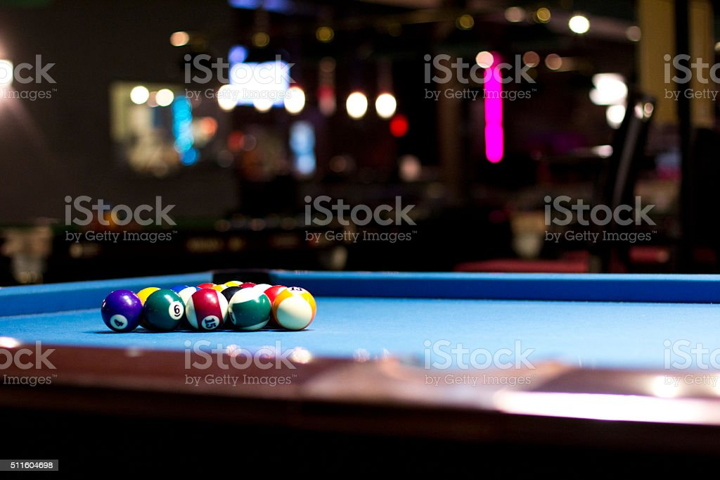 Blue Pool table with balls stock photo