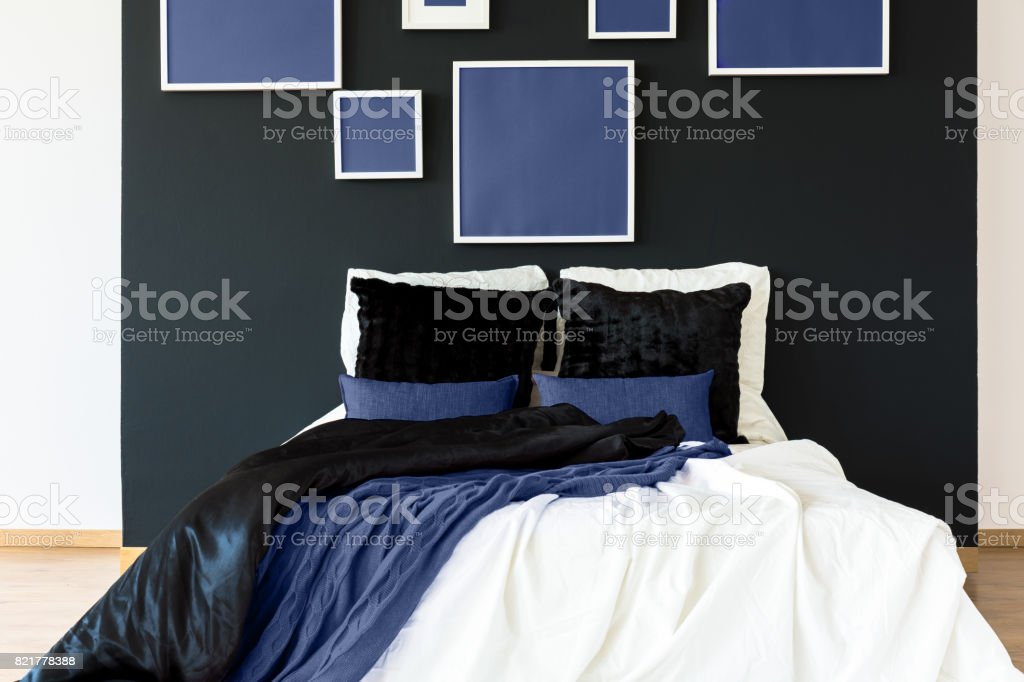 Blue posters above bed stock photo