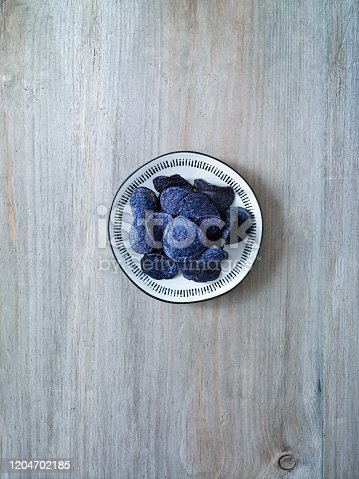 Blue potato chips on a wooden background