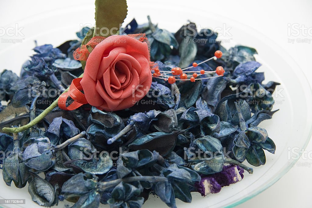 Blue potpourri and rose royalty-free stock photo