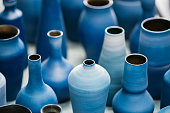 istock Blue pottery works in okinawa 694329856