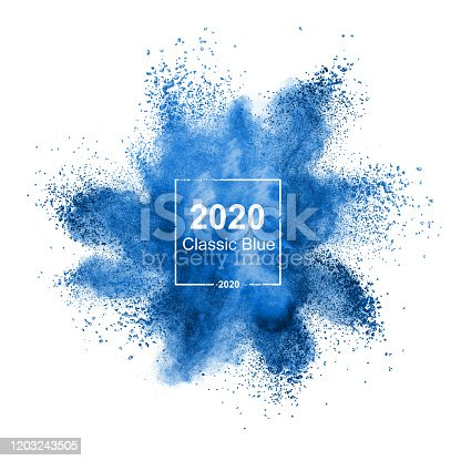 1131535585 istock photo Blue powder explosion in color of 2020. 1203243505