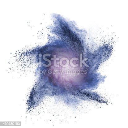 istock Blue powder explosion isolated on white 492530193