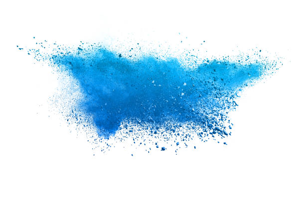 Blue powder explosion. The particles of charcoal splatter on white background. Closeup of colored dust particles splash isolated on background. Blue powder explosion. The particles of charcoal splatter on white background. Closeup of colored dust particles splash isolated on background. powder snow stock pictures, royalty-free photos & images