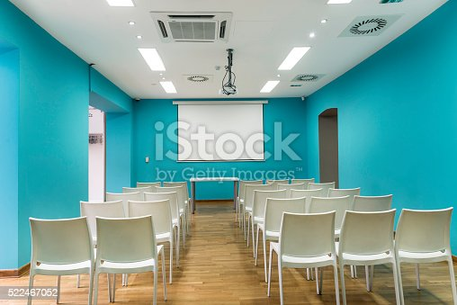 847512708 istock photo Blue presentation room with white chairs 522467052