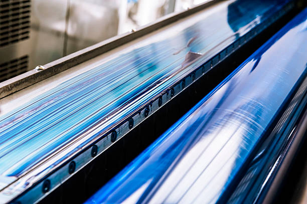 Blue Printing Roller of a CMYK Industrial Lithograph Printer stock photo