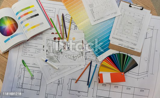 Blue prints, color swatch, pencil colors, sketches, plans and documents for a home renovation - No people
