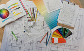 istock Blue prints, color swatch, pencil colors, sketches, plans and documents for a home renovation 1181691218