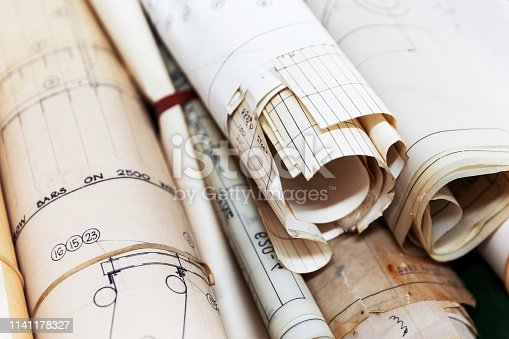 istock Blue Prints Rolled Together & Disused In Modern Engineering 1141178327