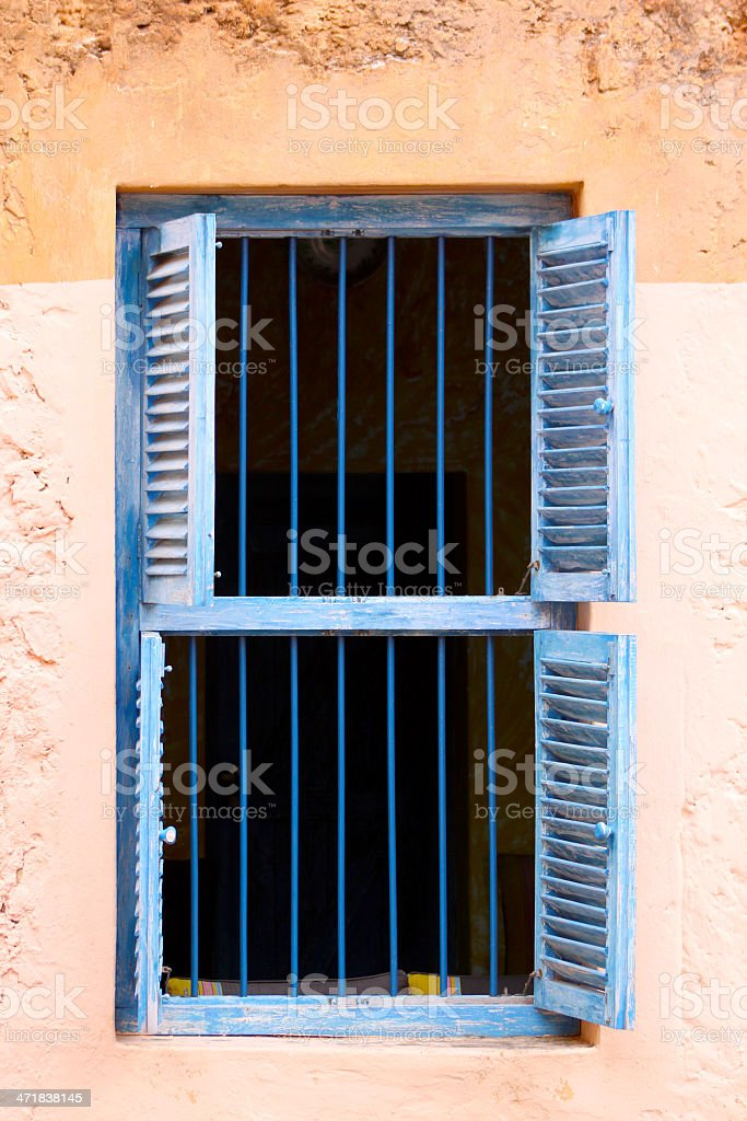 Blue Prison Bars And Wooden Louvred Shutters royalty-free stock photo