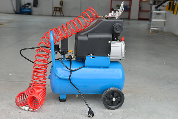 Blue pump compressor for washing cars, indoor. Cleaning concept. Blue pump compressor for washing cars, indoor. Cleaning concept. compressor stock pictures, royalty-free photos & images