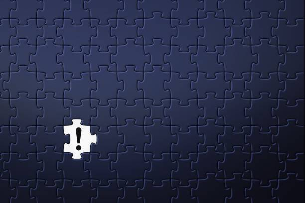 Blue puzzle background with exclamation mark stock photo