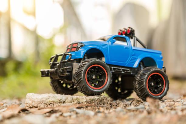 Blue rc offroad truck car standing on the rock and terrain sand dune picture id854489964?b=1&k=6&m=854489964&s=612x612&w=0&h=mtii1sbintzj7eiol8wsiljiw05soobgelypsdqaqek=