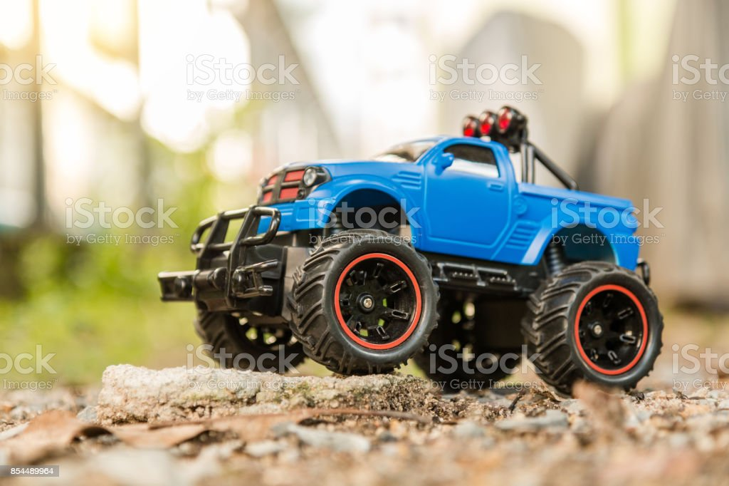 Blue RC Off-road truck car (Radio-controlled) standing on the rock and terrain sand dune stock photo