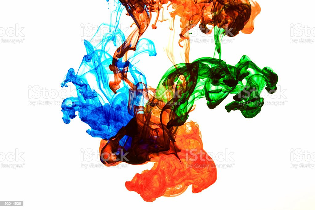 Blue, red and green ink dispersing in water royalty-free stock photo