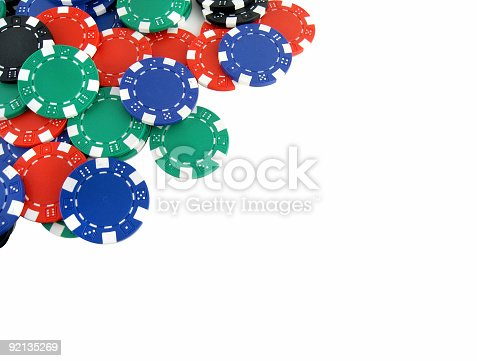 Poker chips on white background with space for text