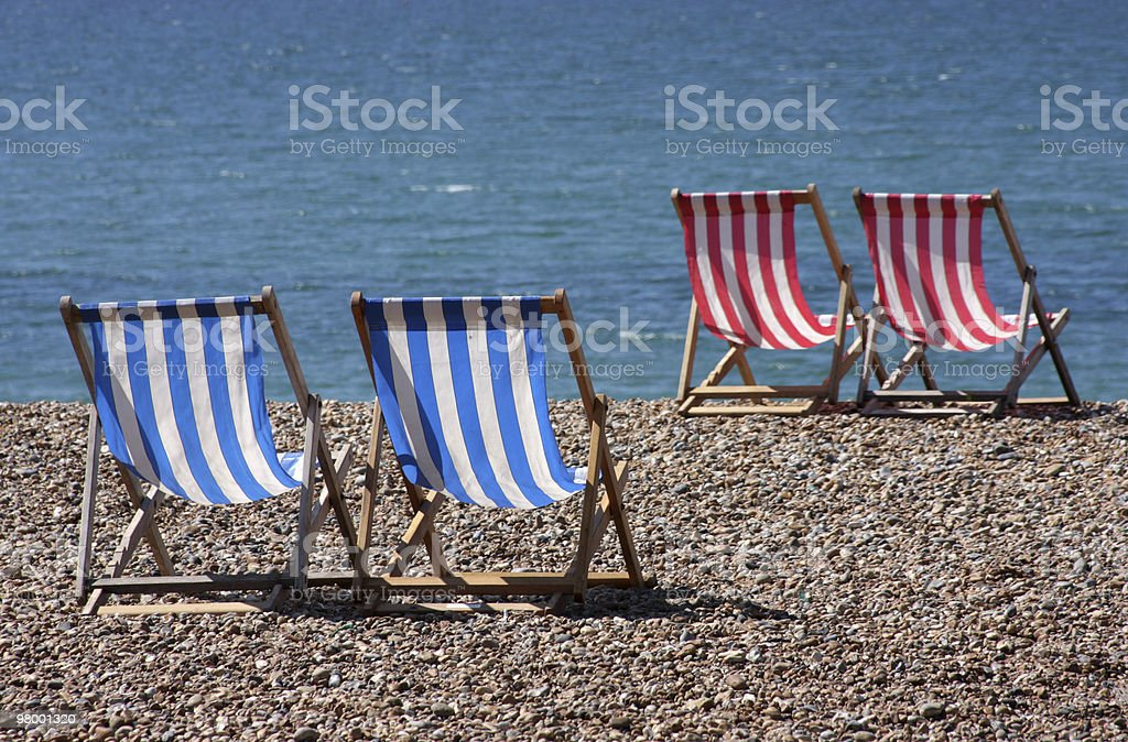 Blue & Red Deck Chairs royalty-free stock photo