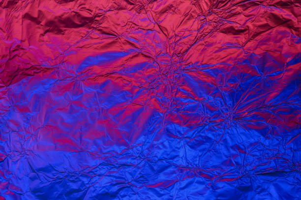 Blue red deformed background made of neon lights foil. Trendy duotone texture Blue red deformed background made of neon lights foil. Trendy duotone texture. electro music stock pictures, royalty-free photos & images