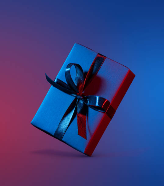 Blue red gift box close up on colorful background stock photo