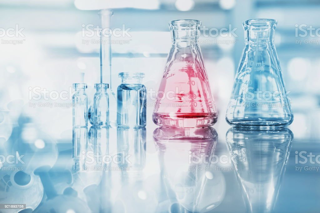 blue red glass flask vial and chemical structure in research medical science technology background stock photo