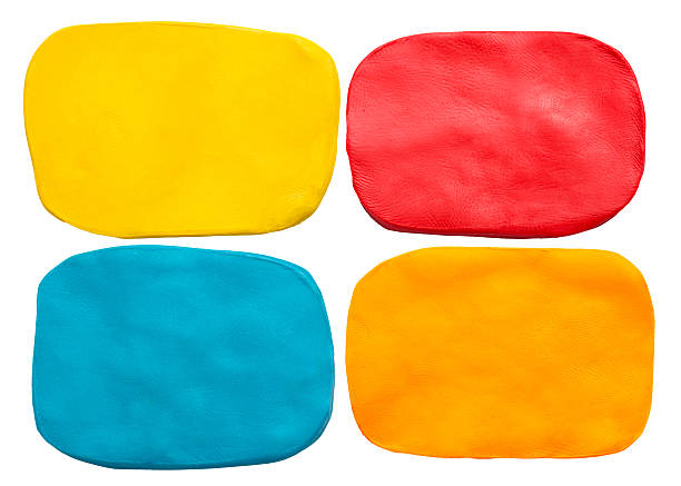 Blue, red, yellow and orange plasticine texture isolated on white colorful plasticine texture isolated on white background clay stock pictures, royalty-free photos & images