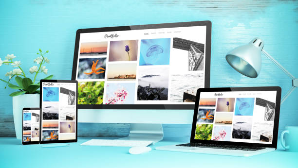 blue responsive desktop with devices showing responsive portfolio website stock photo