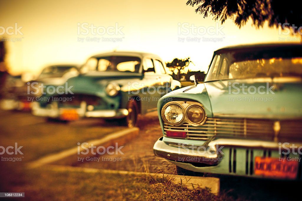 Blue retro American cars in Cuba with aged photo filter stock photo
