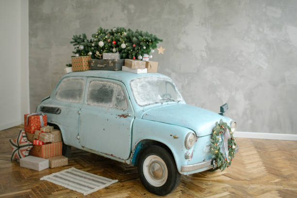 Blue retro car with christmas tree on the roof indoor stock photo