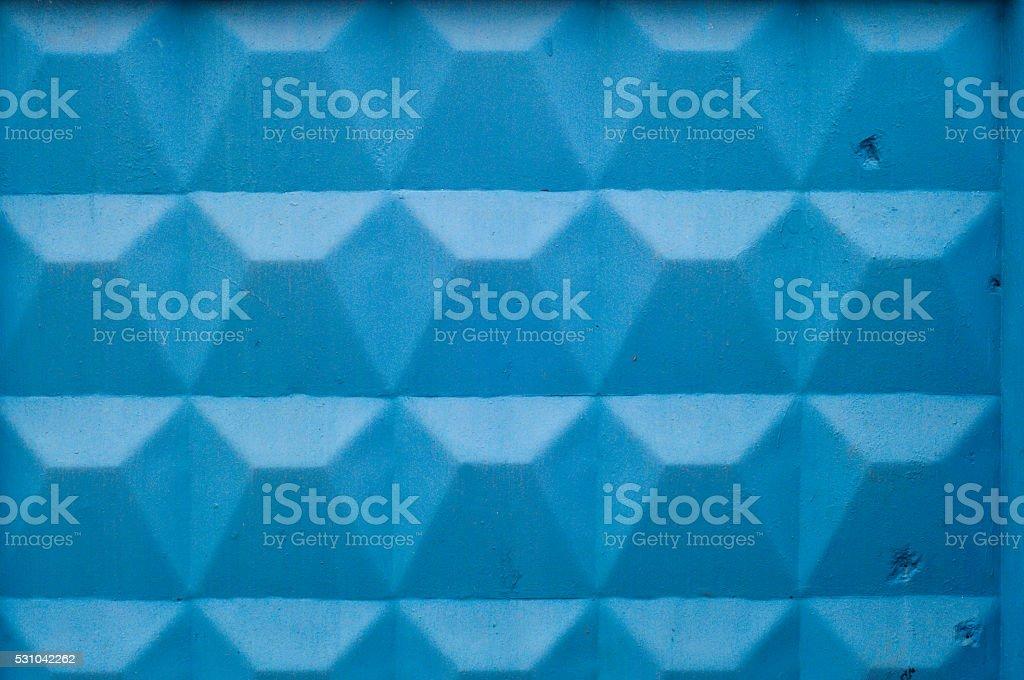 Blue rhombus on a wall stock photo