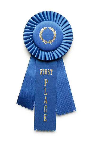 blue ribbon first place - award ribbon stock photos and pictures
