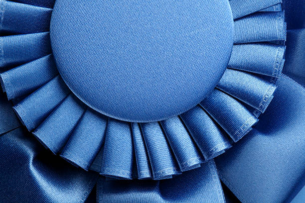 blue ribbon - award ribbon stock photos and pictures