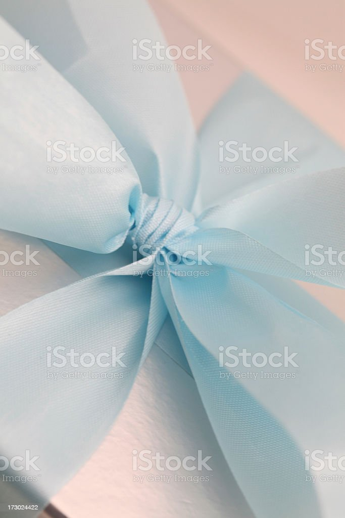 Blue Ribbon Wrapped On A Present royalty-free stock photo