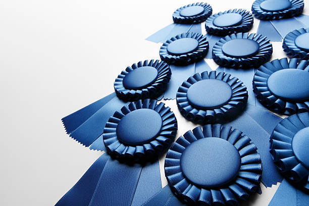 blue ribbons - award ribbon stock photos and pictures