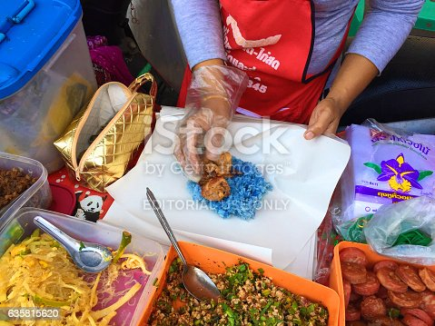 Chiang Mai, Thailand - December 1, 2016: Blue rice being prepared for breakfast food