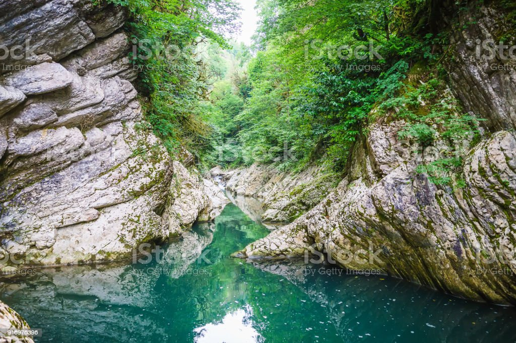 Blue river and stones in forest stock photo