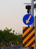 Blue road sign left with lamp