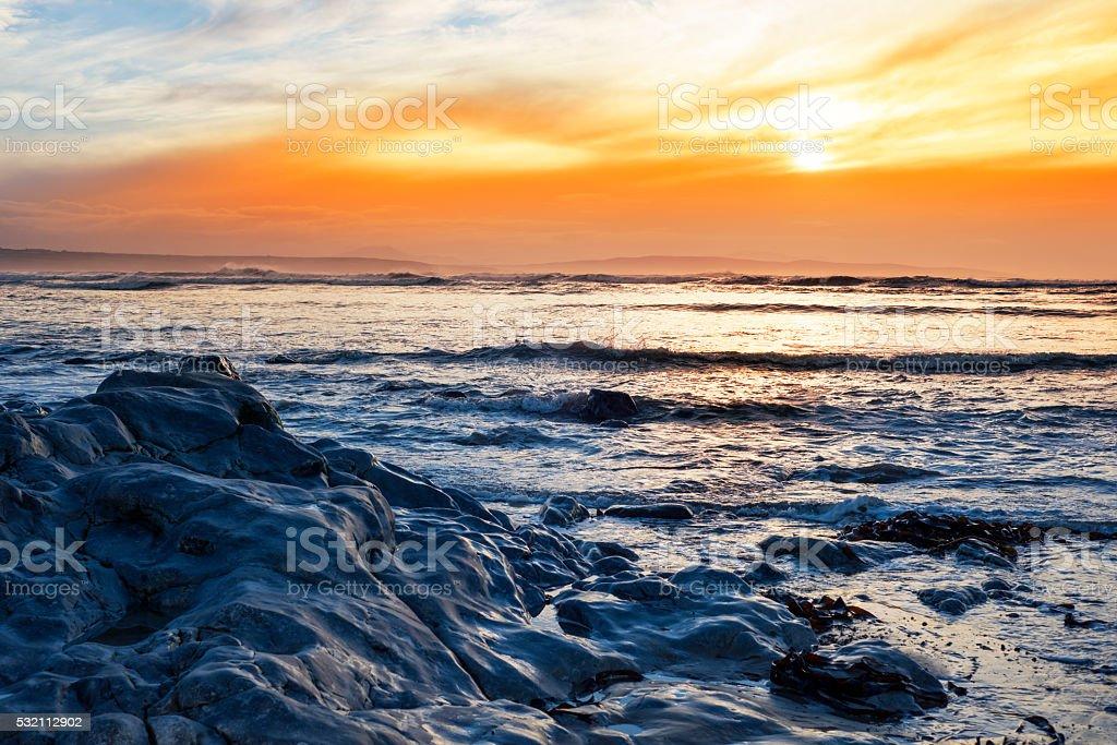 blue rocks at rocky beal beach stock photo