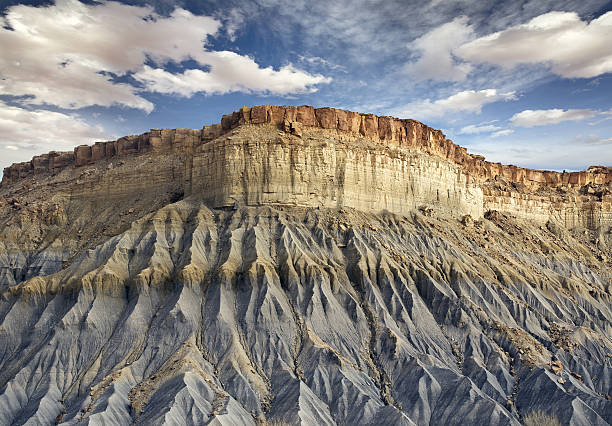 blue rocky cliff in Utah bottom view of a blue rocky cliff in Utah eroded stock pictures, royalty-free photos & images