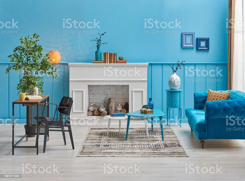 Modern blue room, blue wall background, white fireplace, blue sofa...