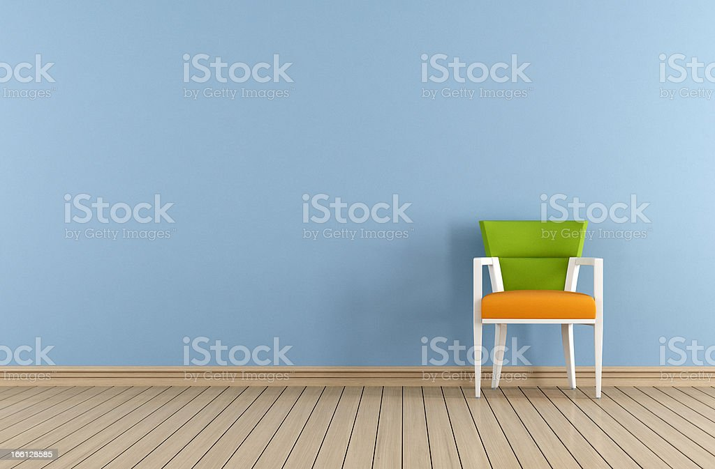 Blue room with colorful chair royalty-free stock photo