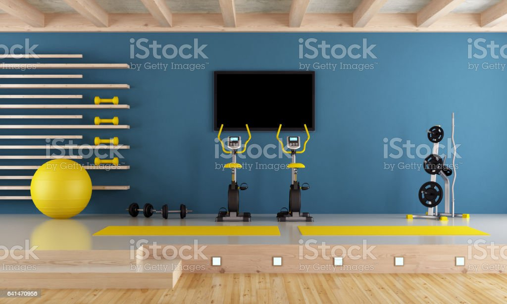 Blue room with gym equipment stock photo