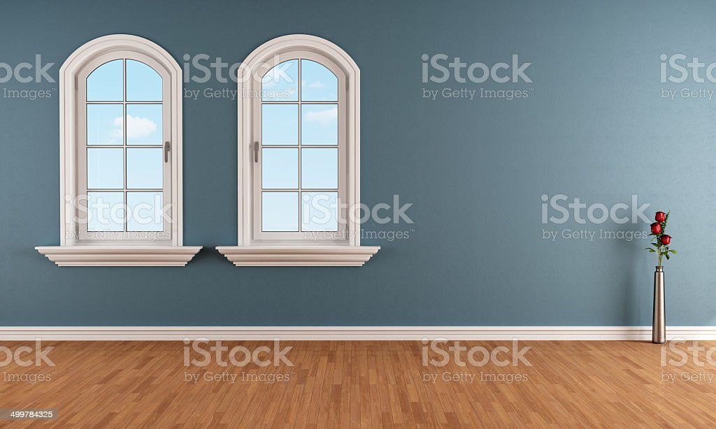 Blue room with two arched windows stock photo