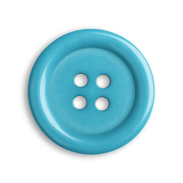 Blue, round button with four holes in the middle stock photo